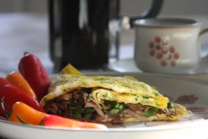 Start your day with LC's ParsleyVeggieOmelette and FrenchPressedCoffee